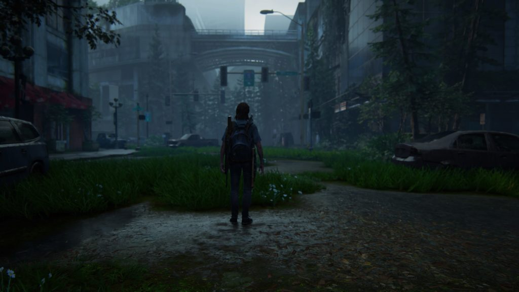 Ellie stands alone in Seattle's abandoned streets, TLOU2